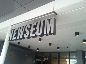 Outside of teh Newseum entrance, the museum displays the day's front pages from every state.